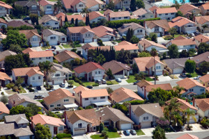 Aerial view of homes in an Irvine neighborhood shot August 5, 2010. ///ADDITIONAL INFO / / / aerials shot 080510 JEBB HARRIS, THE ORANGE COUNTY REGISTER aerial photos shot August 5, 2010 including: JWA terminal const. & takeoffs. John Wayne Airport, Tustin base development & The District. Generic housing trends art, construction mortgage sales development,  El Toro, The great park, balloon, tower, blimp hangars, UCI campus views, Dredging in back bay, Stalled HB beachfront hotel development, Pacific city, condos, shopping, HB offshore oil platform, Huntington Beach surf tournament beach scene, OC Fairgrounds , Orange County Fair.